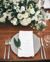 wedding reception menu table setting white floral centerpiece