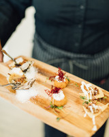 amanda chuck wedding appetizers on wooden tray