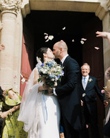 bride and groom kiss outside church doors