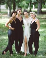 women wearing black spaghetti strap bridesmaids jumpsuits
