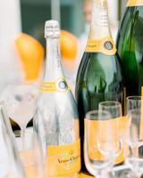 Veuve Cliquot champagne bottles next to flutes