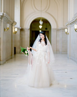 bride wearing Monique Lhuillier wedding dress to city hall venue