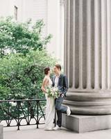 city hall wedding bride and groom against pillar