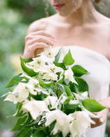 bride with minimal dogwood bouquet