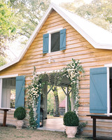 wedding venue greenhouse entrance adorned with floral arch