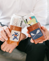 groomsmen cheersing with leather and needle point koozies