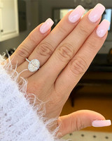 engagement ring selfie white fuzzy sweater and pink nails
