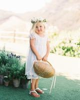 flower girl holding almond shaped wicker basket