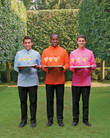 Waitstaff in Colorful Shirts Serving Drinks