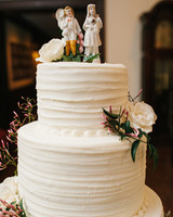 White Wedding Cake with Flowers and Antique English China Figurine Toppers