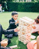 kids playing jenga at wedding