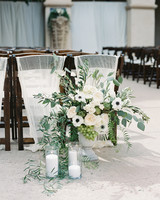 last row ceremony chair decorations white and green floral arrangement and candles
