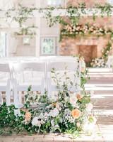 last row ceremony chair decorations white and orange floral arrangements