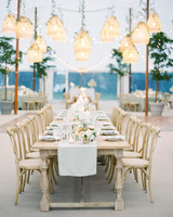 lauren alex wedding reception tables with lights hanging above