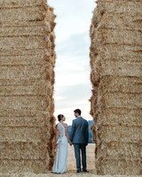weddinng couple hay bales