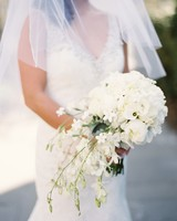 white bouquet with roses and single calla lily