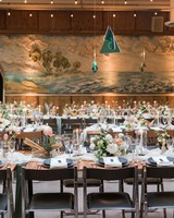 wedding reception tables and place setting with sea glass pendants