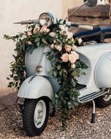 natalie paul wedding ceremony vespa with flowers