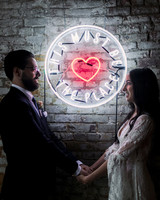 this must be the place neon sign with couple holding hands