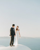 bride and groom standing on Greek coast