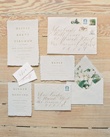 deckle-edge paper invites with foil-pressing and antique floral accents