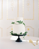 simple two tired white frosted cake with greenery wrapped accent