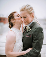 bride kissing wife on cheek
