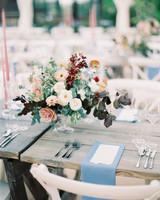 floral centerpieces, blue linens and personalized menus