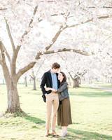couple hugging under tree engagement