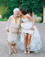 Bride Flashing Garter Alongside Grandmother