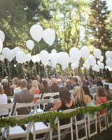 white balloons ceremony chairs