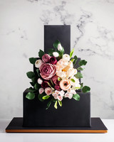 cubed wedding black fondant cake with floral display