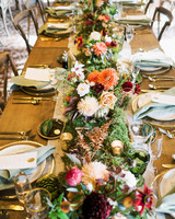 orange and red floral decor, moss, and woodland accents table centerpieces