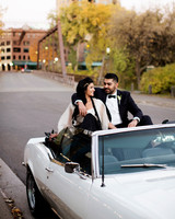 bride and groom sitting in white convertible car