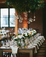 head table hanging greenery lightbulbs