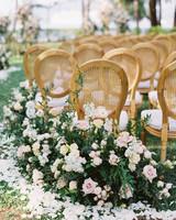 roses and greenery lining wedding aisle