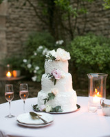 Three Tiered White Wedding Cake With Blush And White Flowers