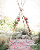 White Wedding Teepee with Pink and Red Flowers