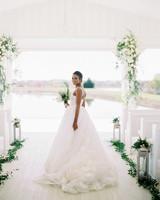wedding bride dress with lake backdrop