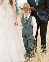 ring bearer wearing cowboy hat and bolo tie