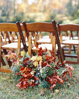 Colorful fall leaf arrangement behind chair