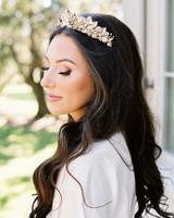 metallic wedding headpiece on bride