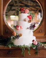 wedding cake with scattered flowers