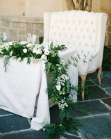 sweetheart table outdoor white chair and garland