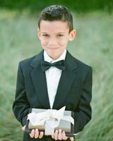 ring bearer holding books at wedding