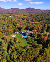 birds-eye view of vermont hotel surrounded by fall foliage