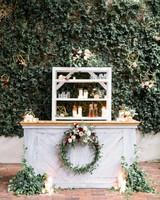 wedding wreaths decorating outdoor bar