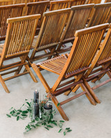 wedding ceremony wooden chairs candles greenery