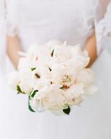 bee wedding ideas bride holding bouquet
