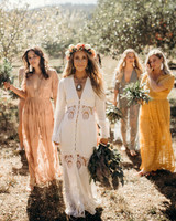 women outdoors wearing lace bridesmaids jumpsuits